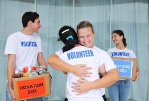 charitable volunteers embracing