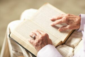 person reading his Bible